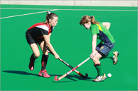 image of children playing girls field hockey
