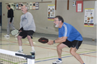 adults playing pickleball