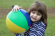 image of child playing with ball