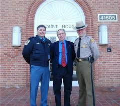 Richard Fritz - States Attorney with SHeriff Cameron and Lt. Thompson