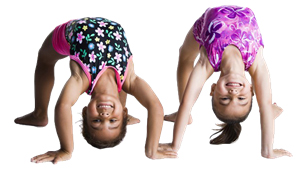 image of two young children in a back bend gymnastic position.