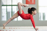image of child on balance beam