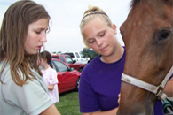 image of teens with horse