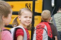 image of children boarding a school bus