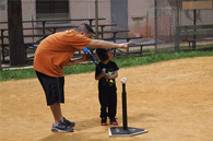 image of child playing t ball