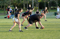 adults playing flag football