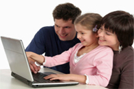 image of family viewing lap top screen