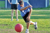 adults playing kickball