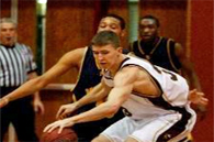 adults playing basketball