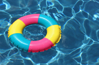 colorful swimming ring floating on top of pool water