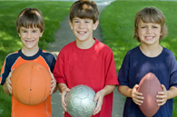image of children holding sports equipment