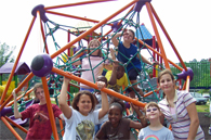image of children playing on playground equipment