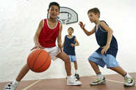 image of children playing basketball