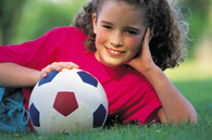 image of young girl with soccer ball