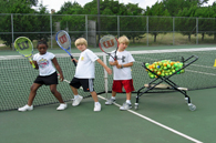 image of children playing tennis
