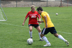 adults playing outdoor soccer