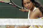 adult playing tennis