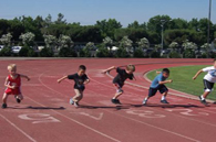image of children running track