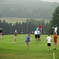 golfers teeing off for annual scott verbic tournament