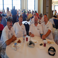 group of adults relaxing at club house table after annual scott verbic  tournament